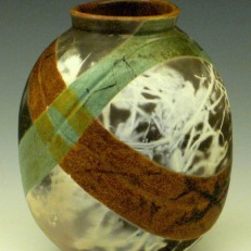 "Waves and Flora Carbon Transfer Study 2009 by Lynn Anne Verbeck Low-fire glaze, then barrel fired with plants 6""H x 3""W x 3""D"